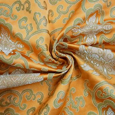 CH0508 チャイナ生地 蓮と唐草 72cm幅 オレンジ(ゴールド)